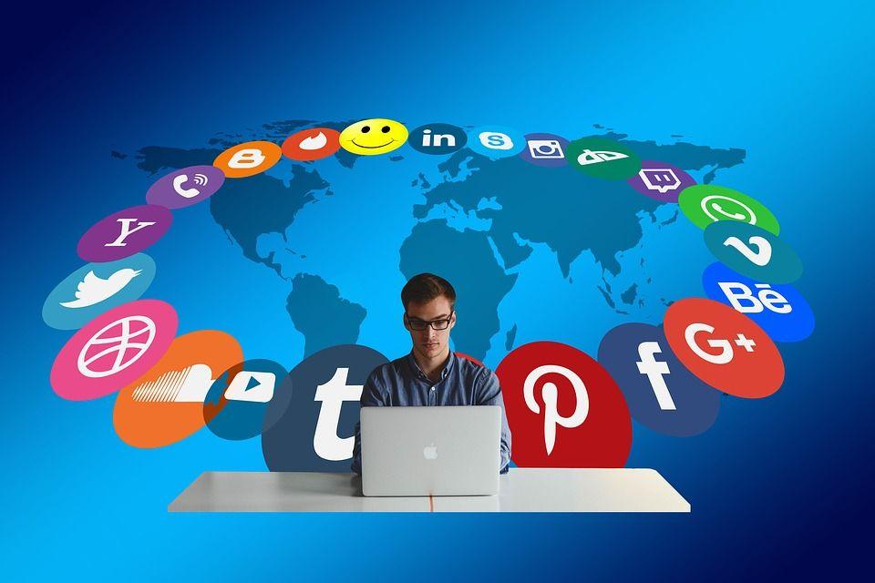 man on social media looking at facebook